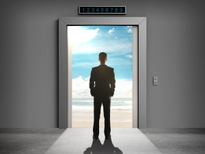 businessman looking at opened elevator